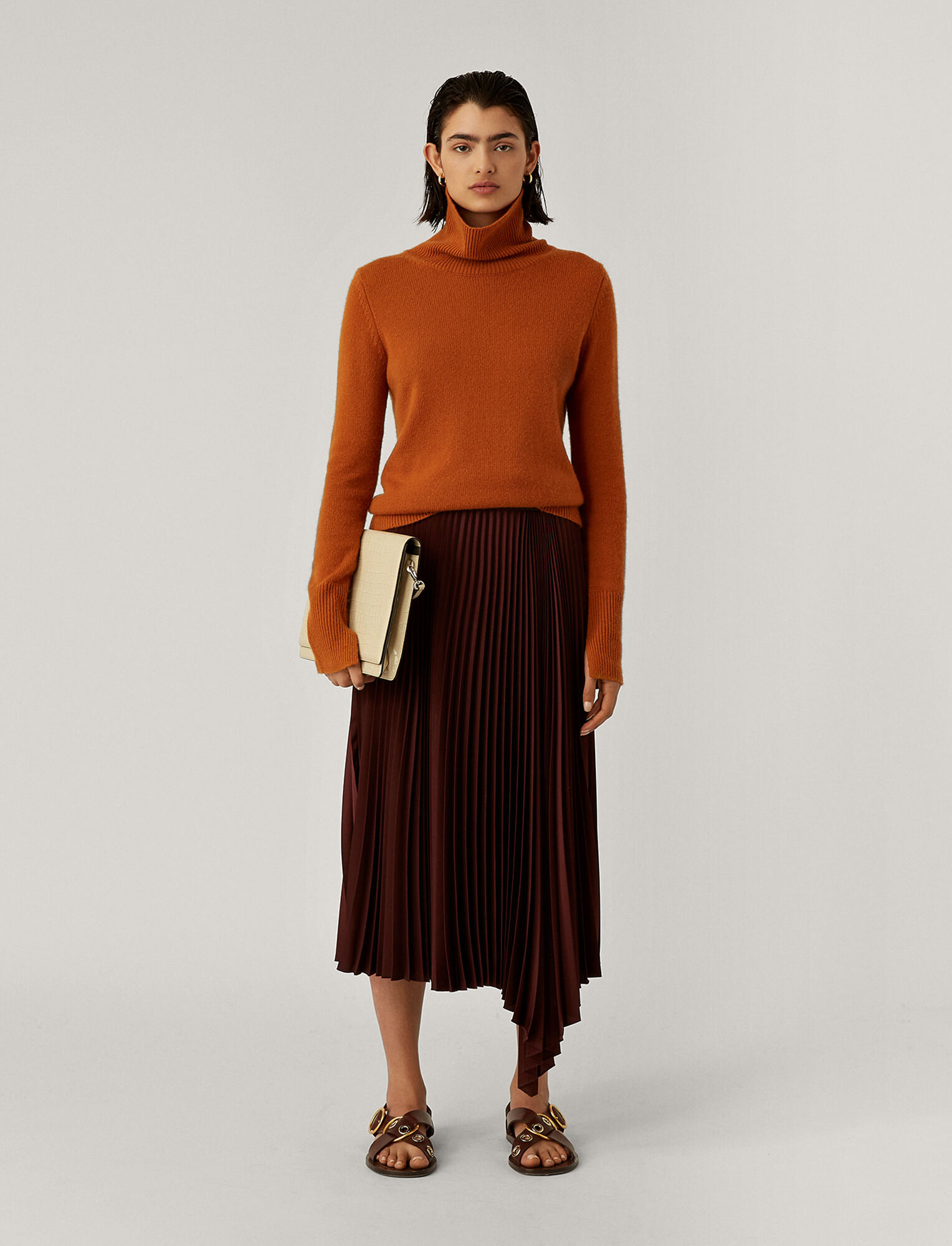 cashmere pullover and silk skirt