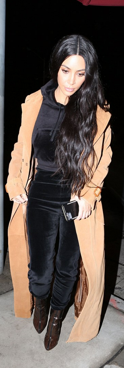 kim kardashian was spotted wearing coat and shoes